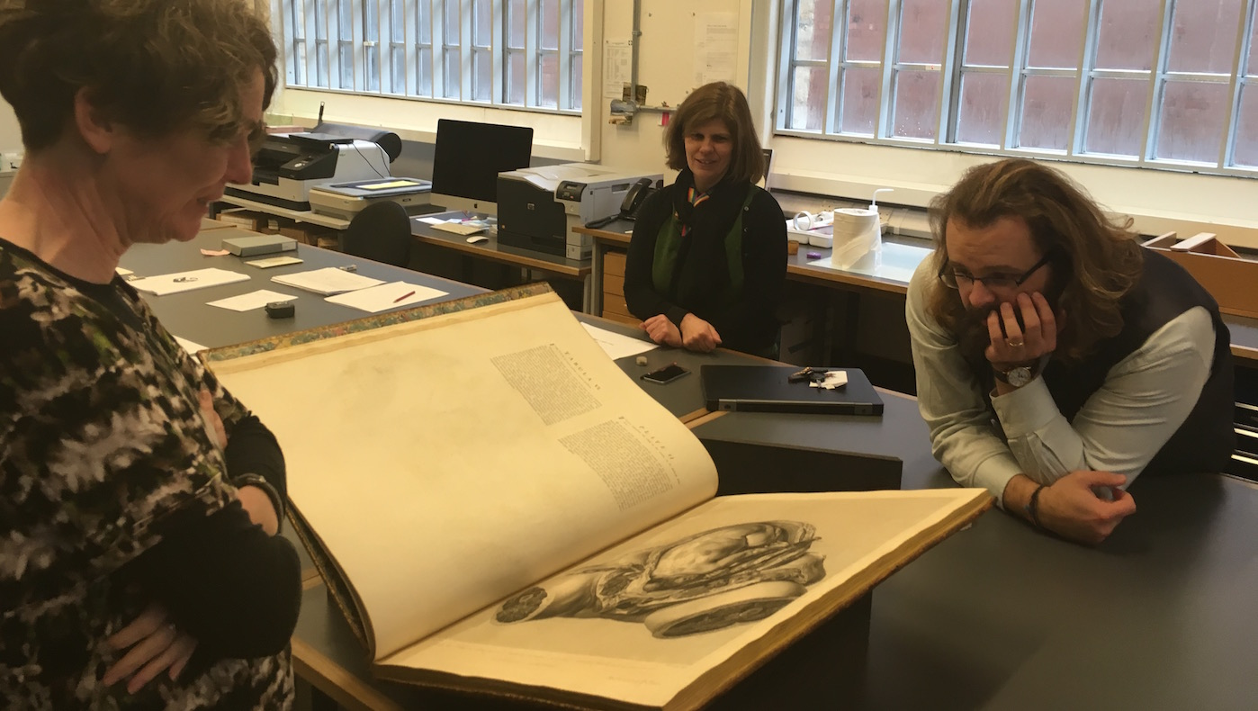 Madeline Slaven (left), Sallyanne Gilchrist (centre), and Daryl Green (right) in front of the selected edition of W. Hunter's <i>Anatomia uteri humani gravidi</i> (1774), BOD, Arch. Nat. Hist. Q.4.