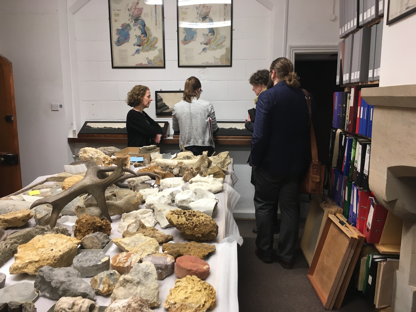 Janet Stott, Madeline Slaven, Daryl Green, and Kelly Richards examining objects related to our project.