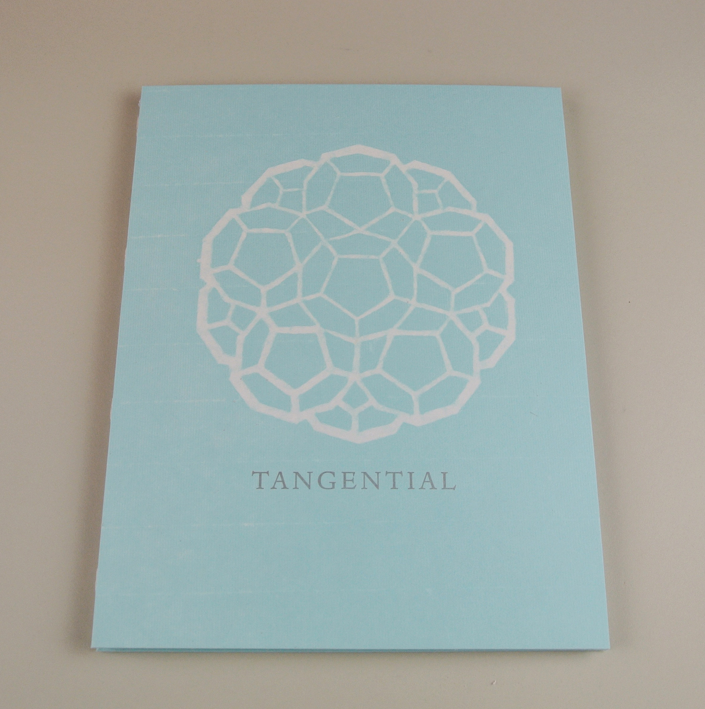 """Cover of Tangential."""
